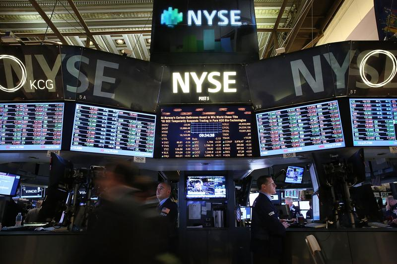 Traders work on the floor of the New York Stock Exchange on November 22, 2013. In early trading the Dow Jones Industrial Average was little changed after closing above 16,000 for the first time ever.