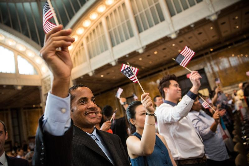A man takes part in an United States naturalization ceremony ahead of Indepedence Day at the New York Public Library.