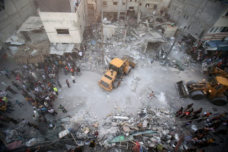 A digger removes the rubble after a militant's home was targeted in an Israeli air raid in the southern of Gaza strip , on July 11, 2014. Five Palestinians, including a woman & 7-year-old child, died.