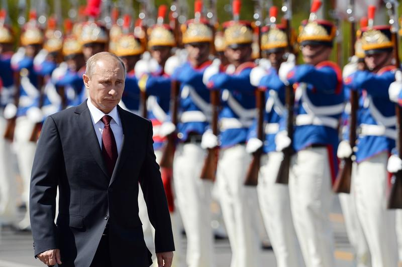 Russian President Vladimir Putin receives military honours during the welcoming ceremony at Planalto Palace in Brasilia on July 14, 2014.