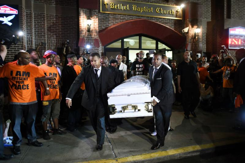 Pallbearers carry out the casket of Eric Garner after the funeral service at the Bethel Baptist Church in Brooklyn