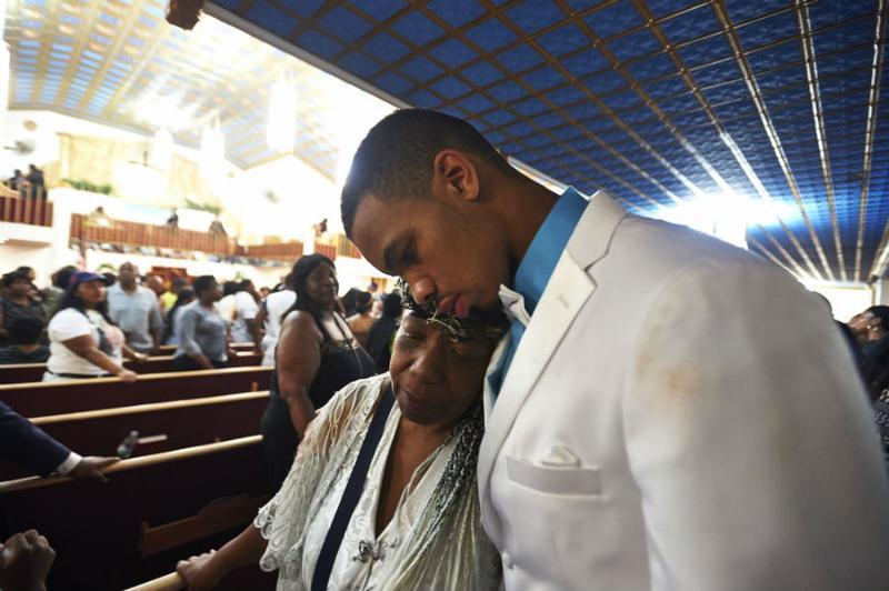 Gwen Carr and Eric Snipes Garner, Jr., mother and son of Eric Garner, at the funeral service for Eric Garner held at Bethel Baptist Church