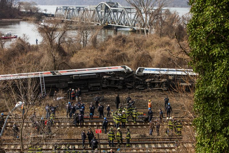 Emergency crews help injured passengers after Metro-North train derailed near the Spuyten Duyvil station December 1, 2013 in the Bronx borough of New York City.