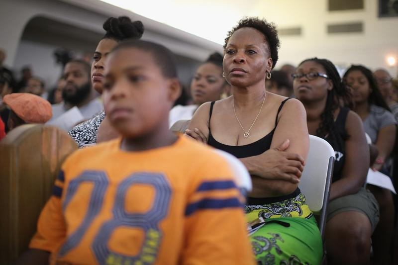 Guests listen to speakers during at a town hall meeting hosted by the St. Louis County NAACP at Murchison Tabernacle Church to discuss the killing of 18-year-old Mike Brown. August 11, 2014