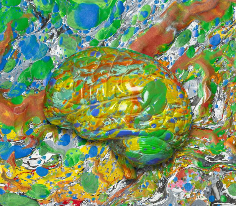 Brain emerging from abstract art background.
