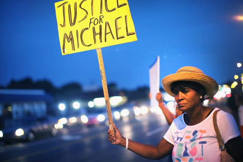 Gwen Stewart joins other demonstrators along West Florissant Avenue to protest the shooting death of Michael Brown on August 14, 2014 in Ferguson, Missouri.