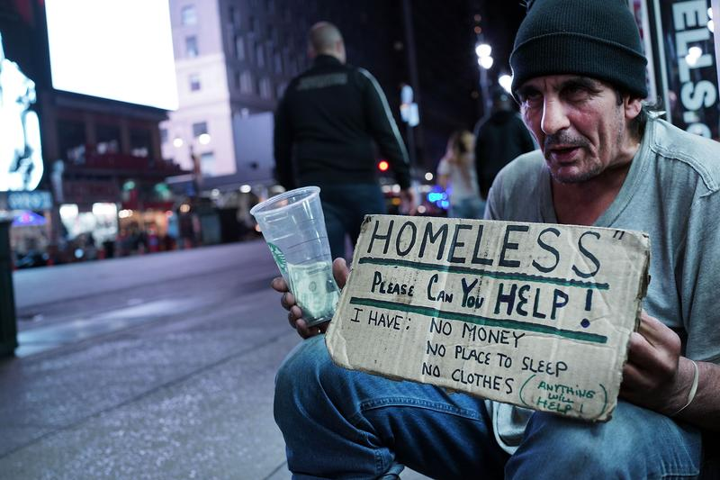 A homeless man begs for money on a Manhattan street.