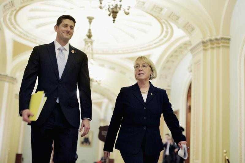 Rep. Paul Ryan (R-WI) and Sen. Patty Murray (D-WA) walk past the Senate chamber on their way to a press conference to announce a bipartisan budget deal. Dec. 10, 2013