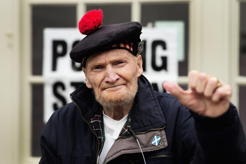 Former Gordon Highlander, Jock Robertson, aged 81, who said 'I have waited all my life for this vote' pauses at Peebles polling station after voting in the Scottish referendum on September 18, 2014.