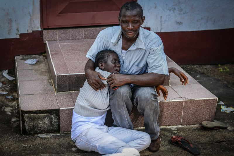 Relatives of Hanfen John who died due to the Ebola virus, mourn for him in Monrovia, Liberia on 10 October, 2014.