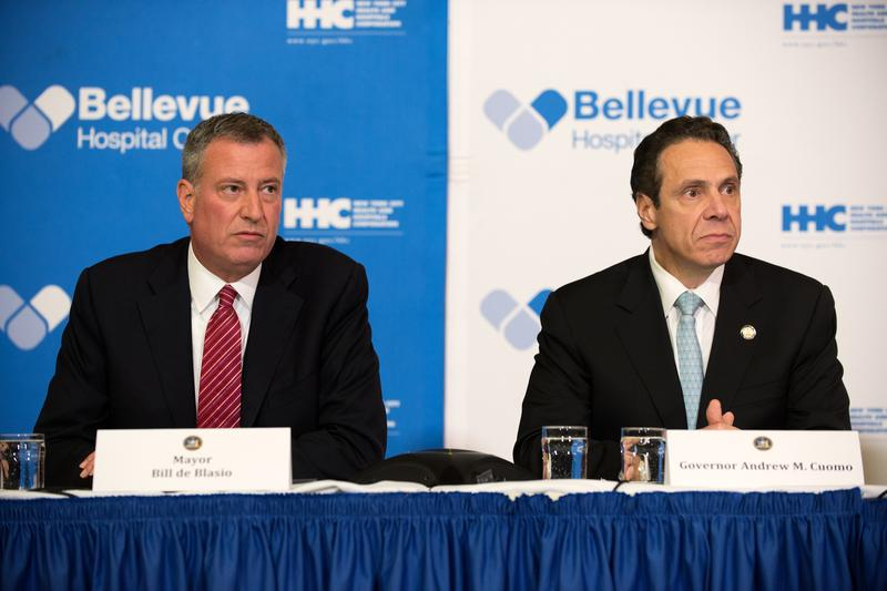 Mayor Bill DeBlasio of New York City and Governor Andrew Cuomo of New York speak at a press conference about Ebola patient Dr. Craig Spencer on October 23, 2014 in New York City.