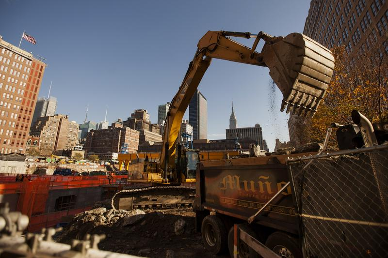 An excavator removes earth from the site where Brookfield Office Properties Inc.'s residential building, 3 Manhattan West, will be built. November 18, 2014