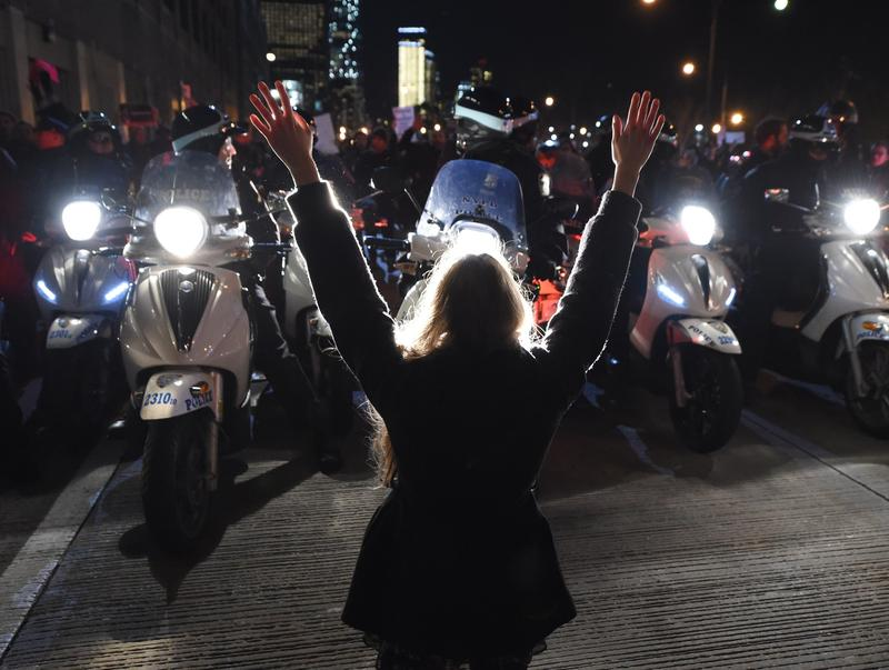 A protestor hold up her hands in front of the NYPD as she and others block traffic on the West Side Highway to protest the non-indictment in the case of Eric Garner. December 4, 2014 in New York City.