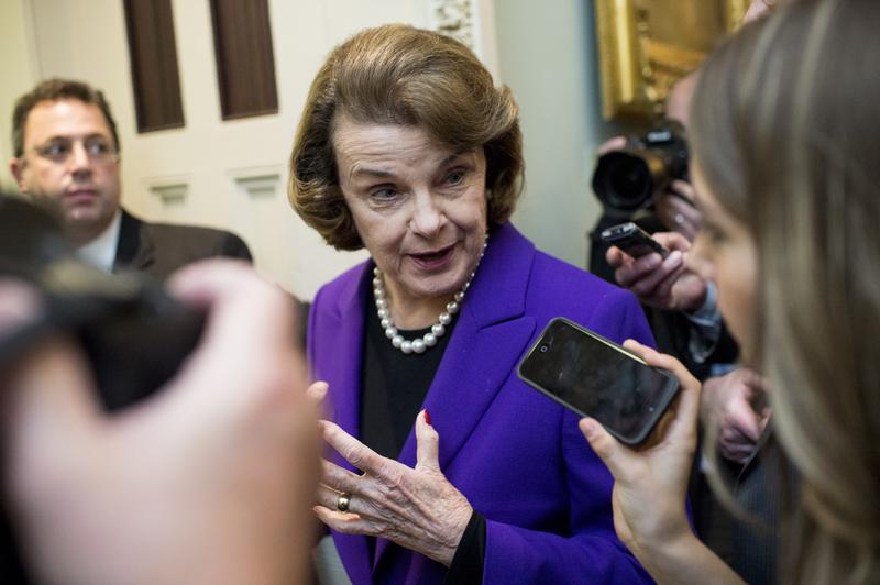 Senate Intelligence Committee chair Sen. Dianne Feinstein, D-Calif., leaves the Senate floor after speaking about the CIA torture report being released by the committee on Tuesday, Dec. 9, 2014.