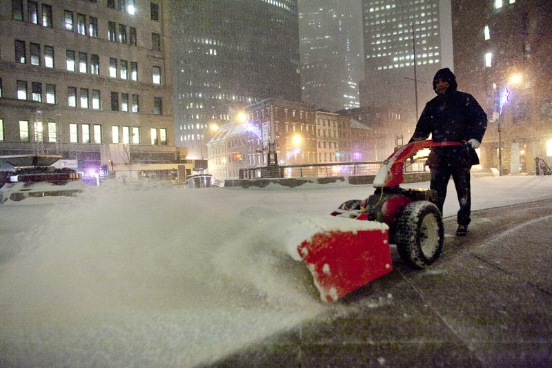 A man plows snow during winter storm 'Hercules' in lower Manhattan January 2, 2014 in New York City. The storm is expected to dump up to 10 inches of snow overnight.