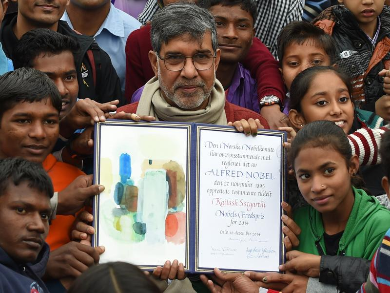 Nobel Peace Prize winner Kailash Satyarthi poses with children after paying tribute at Raj Ghat, the memorial for India's founding father Mahatma Gandhi, in New Delhi. December 14, 2014