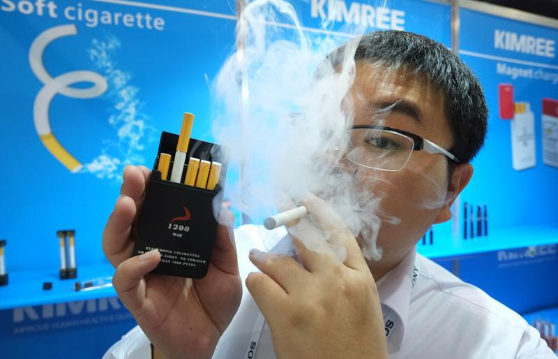 Bin Zhou of Kimree shows electronic cigarettes at the Kimree booth during the 2014 International CES at the Las Vegas Convention Center on January 8, 2014 in Las Vegas, Nevada.