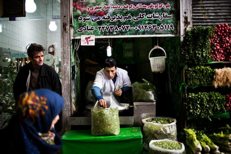 An Iranian man prepares some chopped mixed vegetables for Iranian dish recipes at Tajrish bazaar in northern Tehran on January 24, 2015.