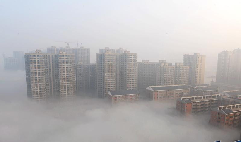 Buildings are shrouded in smog on January 14, 2014 in Changsha, Hunan Province of China.