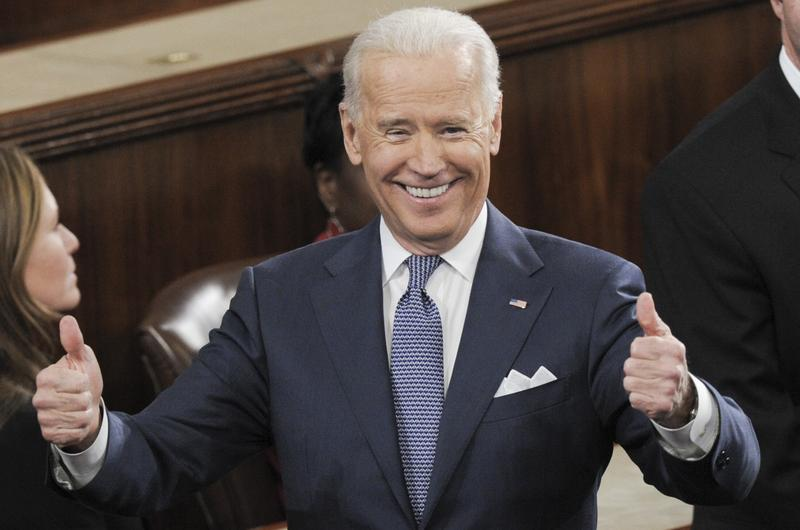US Vice President Joe Biden gives two thumbs-up prior to US President Barack Obama delivering the State of the Union address before a joint session of Congress on January 28, 2014.