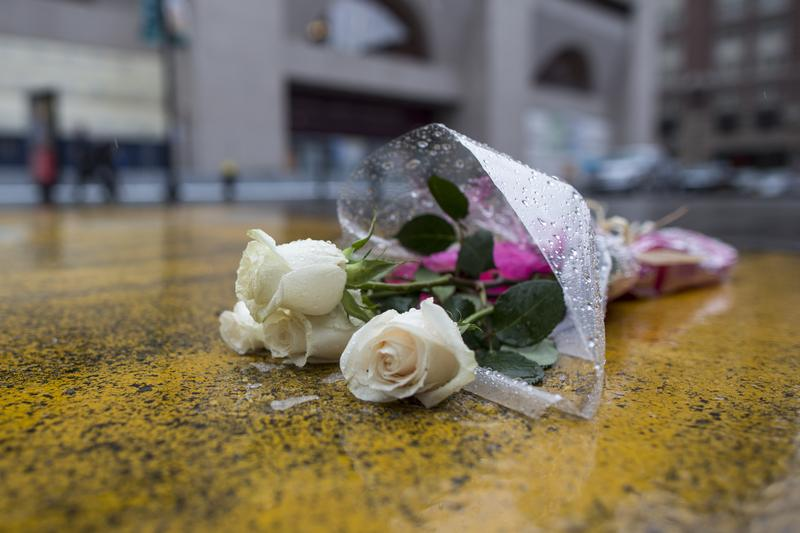 Flowers placed on the Boston Marathon finish line on Boylston St. on April 8, 2015, the day Dzhokhar Tsarnaev, 21, was found guilty on all 30 counts related to his involvement in the 2013 bombings.