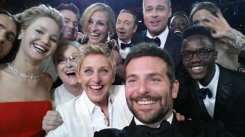 Ellen DeGeneres takes a selfie during a heavily mocked Oscars ceremony.