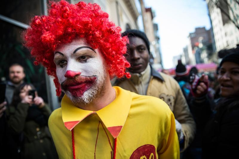 A man named Ben, who chose not to give his last name, dressed as the McDonald's mascot Ronald McDonald, participates in a protest for higher wages for fast food workers on March 18, 2014 in New York.