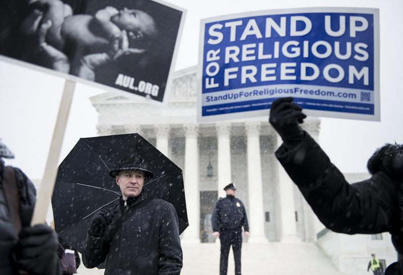 People who support Hobby Lobby's choice to withhold contraceptive healthcare coverage from their employees rally outside the US Supreme Court March 25, 2014 in Washington, DC.