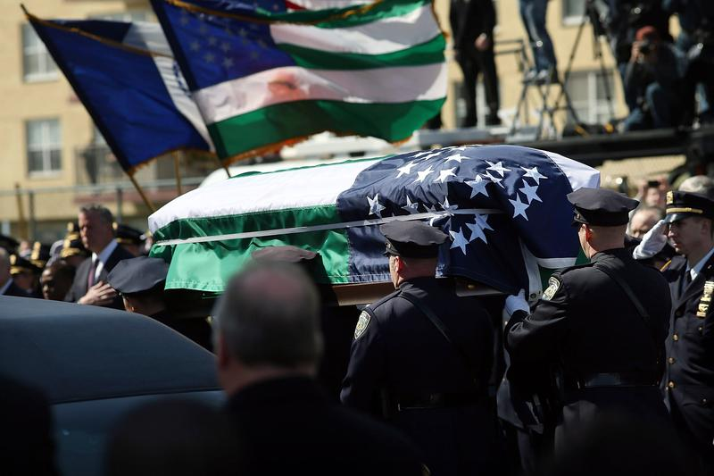 The coffin of NYPD officer Dennis Guerra is brought into the St. Rose of Lima Church in Far Rockaway on April 14.
