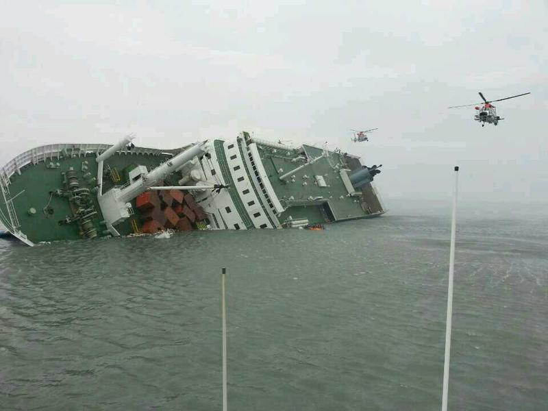 In this handout image provided by the Republic of Korea Coast Guard, a passenger ferry sinks off the coast of Jindo Island on April 16, 2014 in Jindo-gun, South Korea.