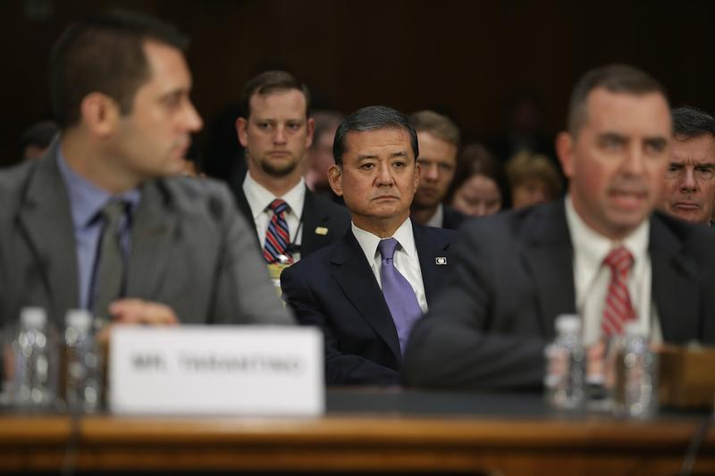 U.S. Veterans Affairs Secretary Eric Shinseki (C) listens to representatives testify before the Senate Veterans' Affairs Committee about wait times veterans face to get medical treatment.