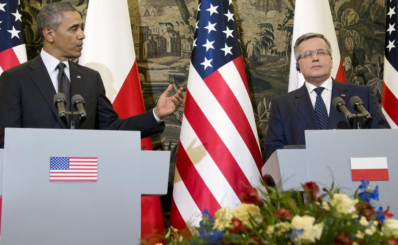 US President Barack Obama (L) speaks during a joint press conference with Polish President Bronislaw Komorowski following meetings at Belweder Palace in Warsaw, Poland, June 3, 2014.