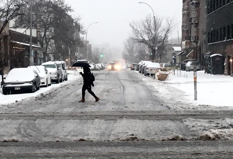 A brave commuter slogs through the slush on 4th avenue in Brooklyn.