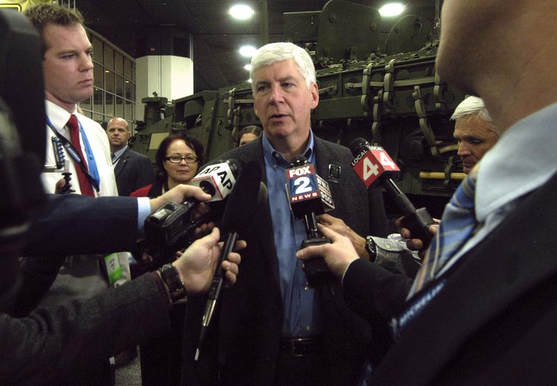 Michigan Governor Rick Snyder talks to reporters on Tuesday, during the press preview for the 2016 North American International Auto Show at Cobo Hall on January 12, 2016 in Detroit, Michigan.