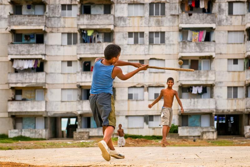 Cuban children playing baseball. June 07, 2009