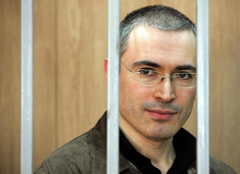 The imprisoned former head of Yukos oil company, Mikhail Khodorkovsky, stands in the defendant's box during his trial in the court in Moscow, 31 August 2004.