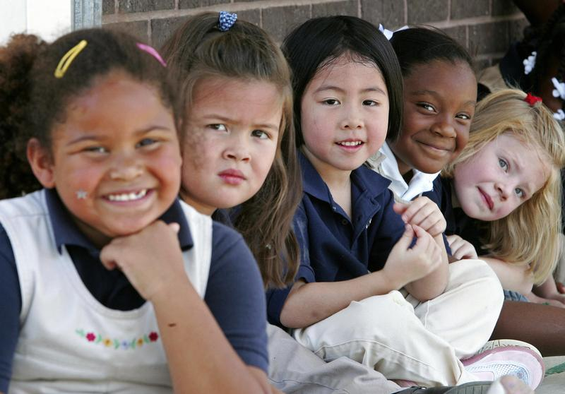 Girls take a break in the play yard at Northwestern Elementary School 07 September 2005 in Zachary, Louisiana.