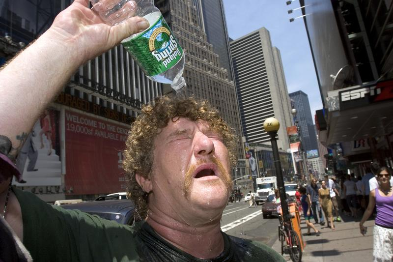 Wayne Semancik of Trenton, New Jersey pours water on his head to cool himself off July 18, 2006 in New York City.
