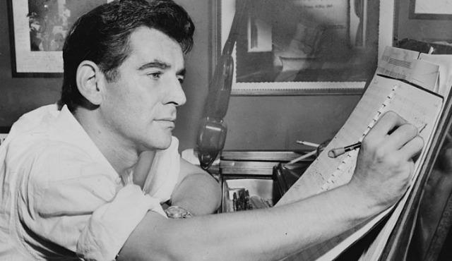 Leonard Bernstein in 1955, making annotations to musical score.