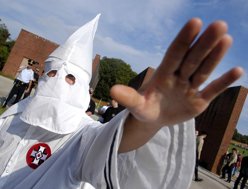 A member of the Ku Klux Klan salutes during American Nazi Party rally at Valley Forge National Park September 25, 2004 in Valley Forge, Pennsylvania.