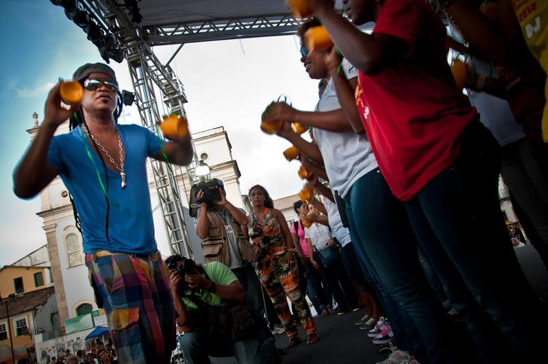 Musician Carlinhos Brown demonstrating the caxirola, Brazil's answer to the vuvuzela