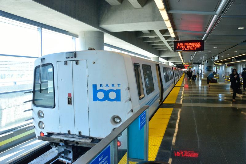 A BART train pulling out of the San Francisco airport station