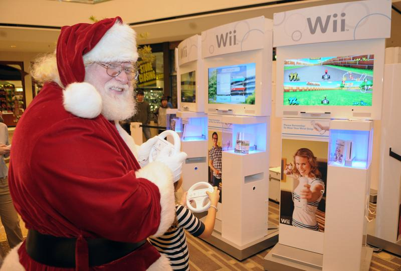 An excited Santa Claus tries out the latest games for the popular Wii system from Nintendo on Black Friday at the Stoneridge Mall on Novermber 28, 2008 in Pleasanton, California.