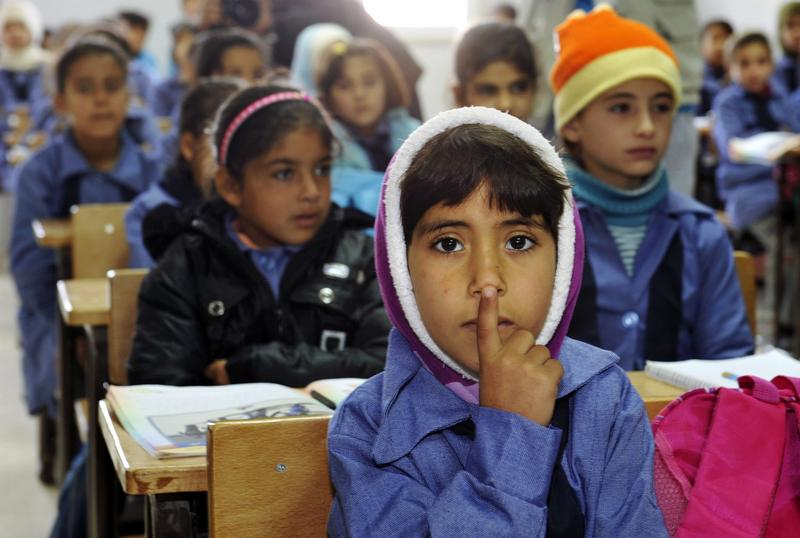 Children inside a classroom at Za'atri refugee camp, host to tens of thousands of Syrians displaced by conflict, near Mafraq, Jordan. December 7, 2012