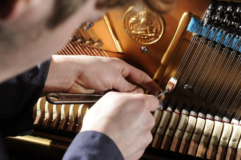 Piano and antique restorer David Robert Eade