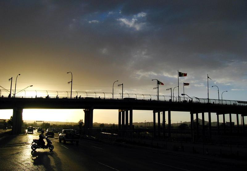 The sun sets over the international bridge linking Ciudad Juarez, Mexico and El Paso, Texas, Tuesday, April 1, 2003.
