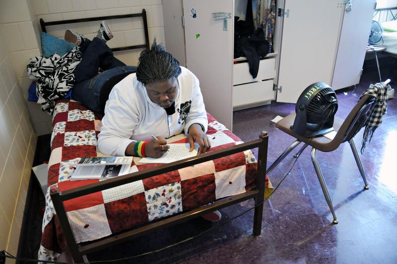 Dec. 22, 2009: Homeless teen Kenesha Hughes writes in her journal at a shelter in Minneapolis. Hughes lived at the shelter for more than three months after her mother stole her money for college.