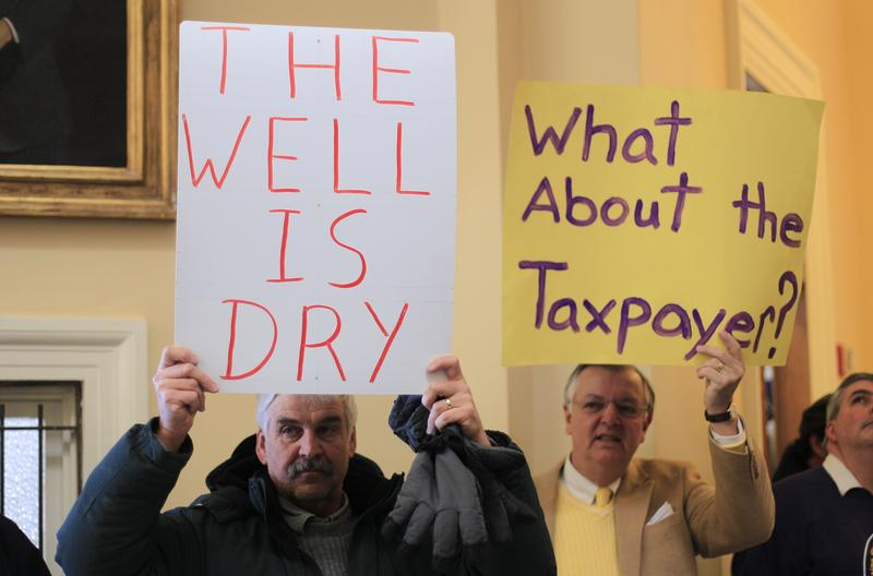 Mark Armstrong, of Lisbon, Maine, left, and and Arthur Langeley, of Durham, Maine, show their support for Gov. Paul LePage's budget proposal at the State House Thursday, March 3, 2011.