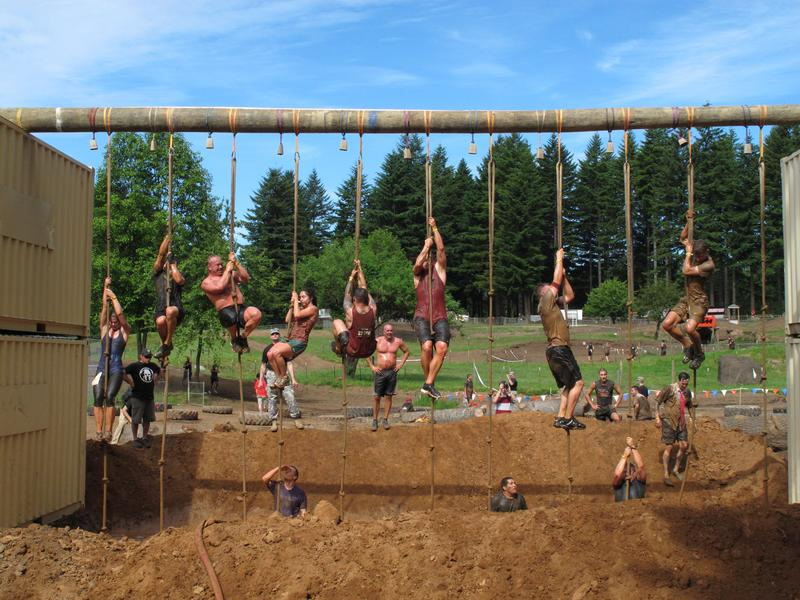 """Competitors tackle an obstacle during the Pacific Northwest """"Spartan Sprint"""" on Saturday, June 16, 2012, in Washougal, Wash."""