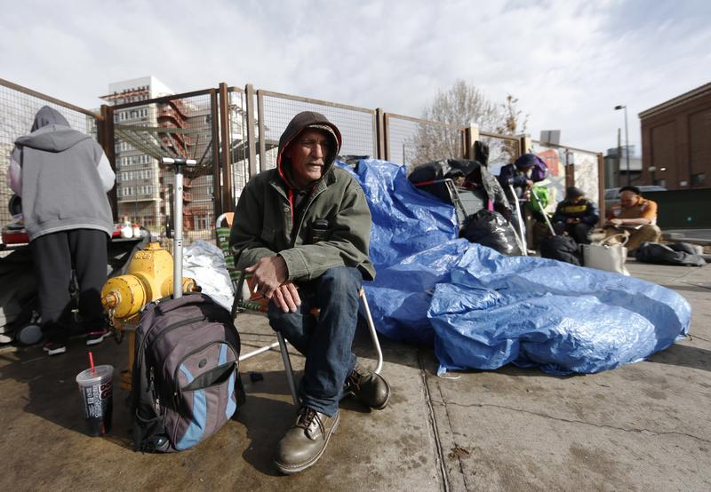 March 7, 2016: Salvatore Garofalo sits in a lawn chair in a makeshift homeless camp across from the Denver Rescue Mission in downtown Denver.